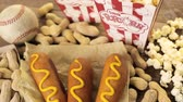 cusine : Game day traditional snacks included corndogs and salted peanuts on a wood board.