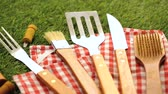 grelhado : Stainless steel barbecue cooking set with wood handles.