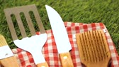 baton : Stainless steel barbecue cooking set with wood handles.