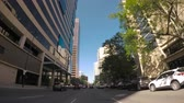 точка зрения : Denver, Colorado, USA-June 16, 2016. Car driving through Downtown Denver during the day-POV point of view.