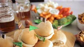 приправа : Sliders with veggie tray on the table for the football party. Стоковые видеозаписи