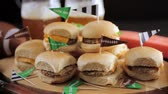 lanche : Sliders with veggie tray on the table for the football party. Vídeos