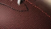 ćwiczenia : Close up of brown leather and white laces of American Football.
