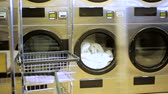 sujo : Industrial washing machines in a public self service laundry