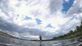 recreativo : Denver, Colorado, USA-July 23, 2016. Recreational paddleboarding on small pond. Stock Footage