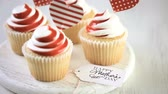 кексы : Gourmet cupcakes for Mothers Day on a wood background.