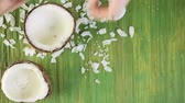 tropikal meyve : Fresh opened coconut on a wood background. Stok Video