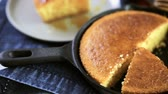 odlitek : Slice of sweet cornbread with honey on the plate.