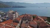 zavala : Flying above the old town of Budva Montenegro towards the city beach, Budva Marina and Adriatic sea with Dukley Zavala on background. Aerial footage. Stock Footage