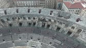 coliseum : Flying over the old Roman amphitheatre in the city of Nimes, France.