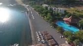 入り江 : Picturesque Turkish bay Kumlubuk. Footage from the drone. View of the Bay with piers and beach.