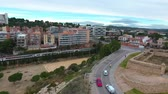 koets : Aerial view of a moving electric train. Tarragona, Spain. Video from the drone. Stockvideo