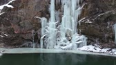 sincelo : Frozen waterfall on the rocks. Winter landscape at the bottom of the gorge.