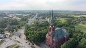 crista : Church in small city among pastures. Red Church is Roman Catholic church. Stock Footage