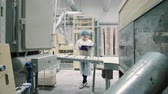 folder : Candy factory. Controller checking conveyor with candies. Stock Footage