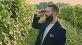barba : Man on vineyard with special instrument