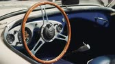 luksus : Old vintage car with interesting interior inside, filming the steering wheel and dashboard