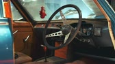 tachimetro : View of dashboard panel and steering wheel of antique car Triumph. Old interior Filmati Stock