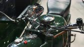 tentoonstelling : Close up of green motorcycle steering wheel and headlight. Retro style