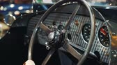 tachimetro : Steering wheel of vintage car. Close-up shot Filmati Stock