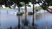 orkan : Alicante, Spain, September 13, 2019: Cars submerged in floodwaters. Depiction of flooding after a hurricane. Suitable for showing the devastation wrought after storms. Flooded Cars in the Parking Road. Deep Waters.