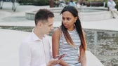 mécontent : Multiracial young woman waiting her boyfriend begin talking and leave his smartphone. She is angry and sad. Finally they reconciled.