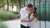 szczęśliwa rodzina : Handsome young man kissing her woman while walking down the street. They are so happy to spend time together. Wideo