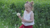 nase : little girl with dandelion flowers