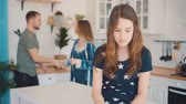Family quarrel in the kitchen with a child