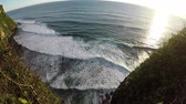 uluwatu : Big long waves from a birds eye view at sunset Stock Footage