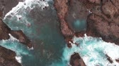 oceano atlântico : The natural pools of the island of Tenerife are a secret place. Aerial view. Cliffs of frozen lava and turquoise ocean