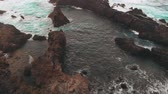 oceano atlântico : The man on the edge of the world AERIAL. The shore of volcanic origin, rocks in the ocean, shots from the drone.