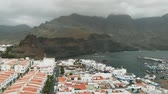 oceano atlântico : Aerial view of Agaete, Gran Canaria, Canary Islands. Port in a small bay with expensive yachts, white houses and a promenade. The mountains Parque Natural Tamadaba