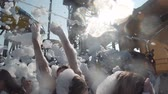 humor : Anapa, Russia - August 17, 2019: A crowd of people dancing and laughing at a foam party in a water park on the seashore Stock Footage