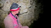 neanderthal : Speleologist take interview about karst cave Stock Footage