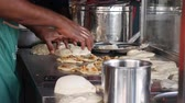 wickeln : Male hands making traditional Indian food called Roti Canai. 4k Stock Footage