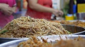 ソースパン : Asian Street food. Fried rice noodles traditional and popular dish in Asia. Closeup. 4k