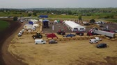 arazi sahibi : MANGUSH, UKRAINE - June 14, 2017: Aerial view of agricultural outdoor expo - Field Day, exhibition of agricultural technologies and machinery for landowners, landlords, farmers and agronomists.