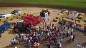rolos : MANGUSH, UKRAINE - June 14, 2017: Aerial view of agricultural outdoor expo - Field Day, exhibition of agricultural technologies and machinery for landowners, landlords, farmers and agronomists.