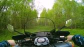 all terrain vehicle atv : Driving ATV in forest POV