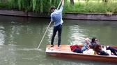 apostador : Punter punts the punt with her passengers on River Cam in Cambridge,UK.