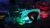 artificial lighting : Beautifully flowing fountain water and multi colored lights illumination