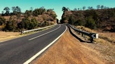 направления : Windy rough road out in the countryside of Gatton, Queensland.