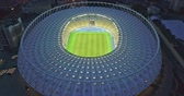 melhoria : Ukraine, Kiev. May 19, 2018. National Sports Complex Olympic, stadium NSC Olimpiysky . Dolly-out pan video 4K from drone. Preparation of a stadium for final of the Champions League 2018.