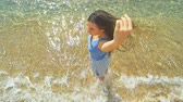 Upper view of woman at beach. Sunny beach and clear blue water. Slow motion. Stok Video