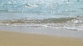 Waves landing on sandy beach. Clear blue water. Slow motion. Stok Video