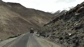 himalaia : car driving on mountain way road hight up to peak top Khardung La pass