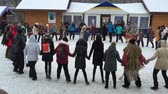 Round dance. People lead a round dance. They are fun and warm.