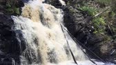 Waterfall Side view. Waterfall Side view. It is located on the territory of the Republic of Karelia, Russia. Shooting was carried out in the summer of 2018. Type of filming - slow. The waterfall is very beautiful Стоковые видеозаписи