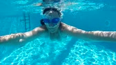 mergulhador : Young woman swims and dives in the beautiful swimming pool Video clip Stock Footage